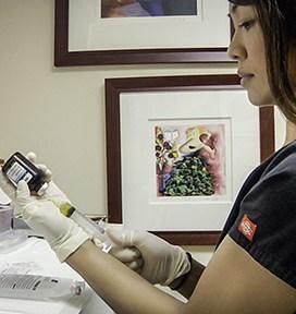 Nurse preparing an IV drip for a patient
